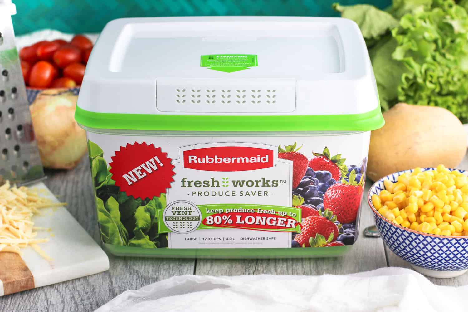 A new Rubbermaid fresh works produce saver surrounded by salad ingredients.
