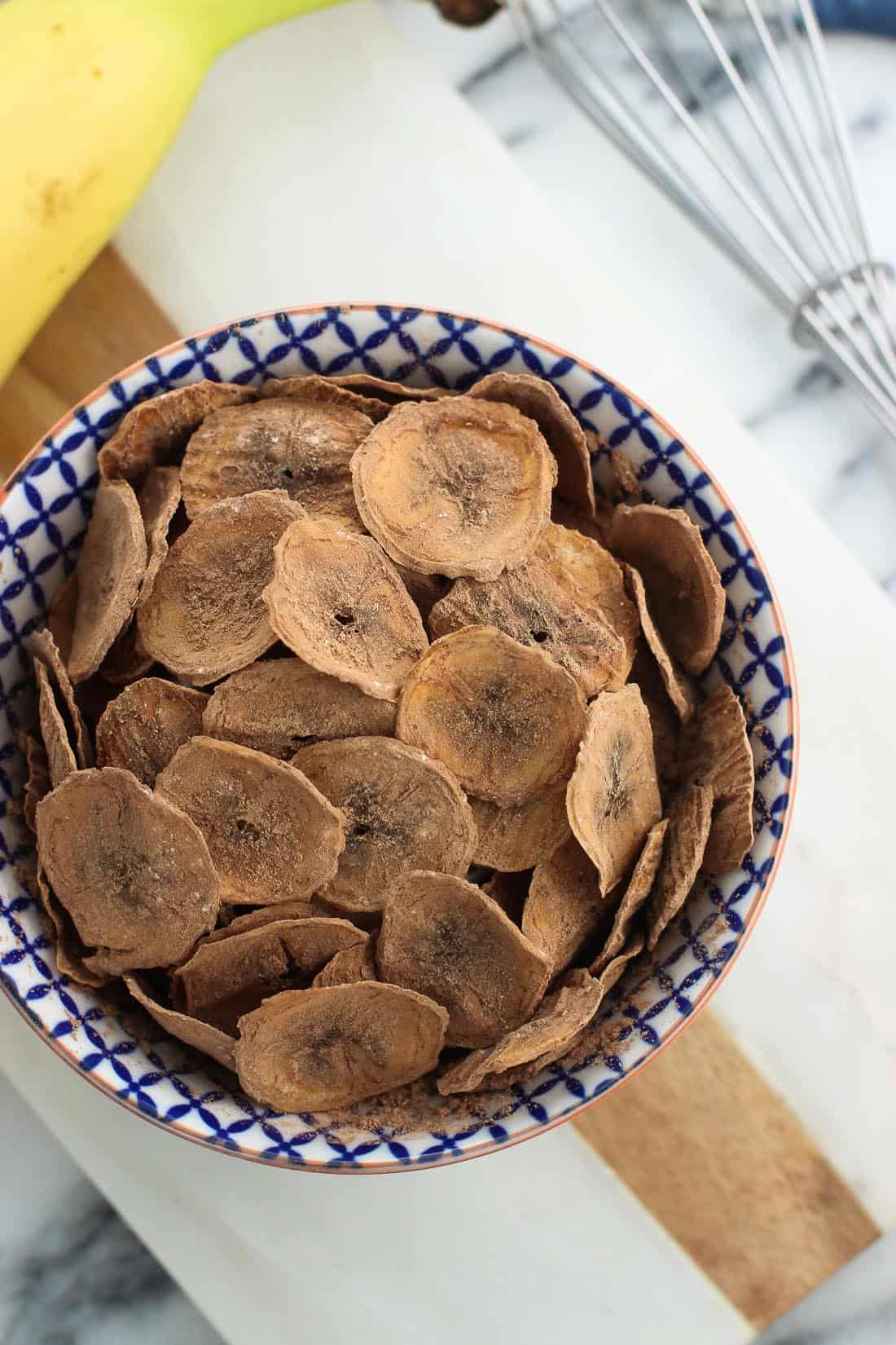 Baked cocoa banana chips are a healthy, oven-baked snack with a satisfying crunch. Just four ingredients are all you need for this easy snack recipe!
