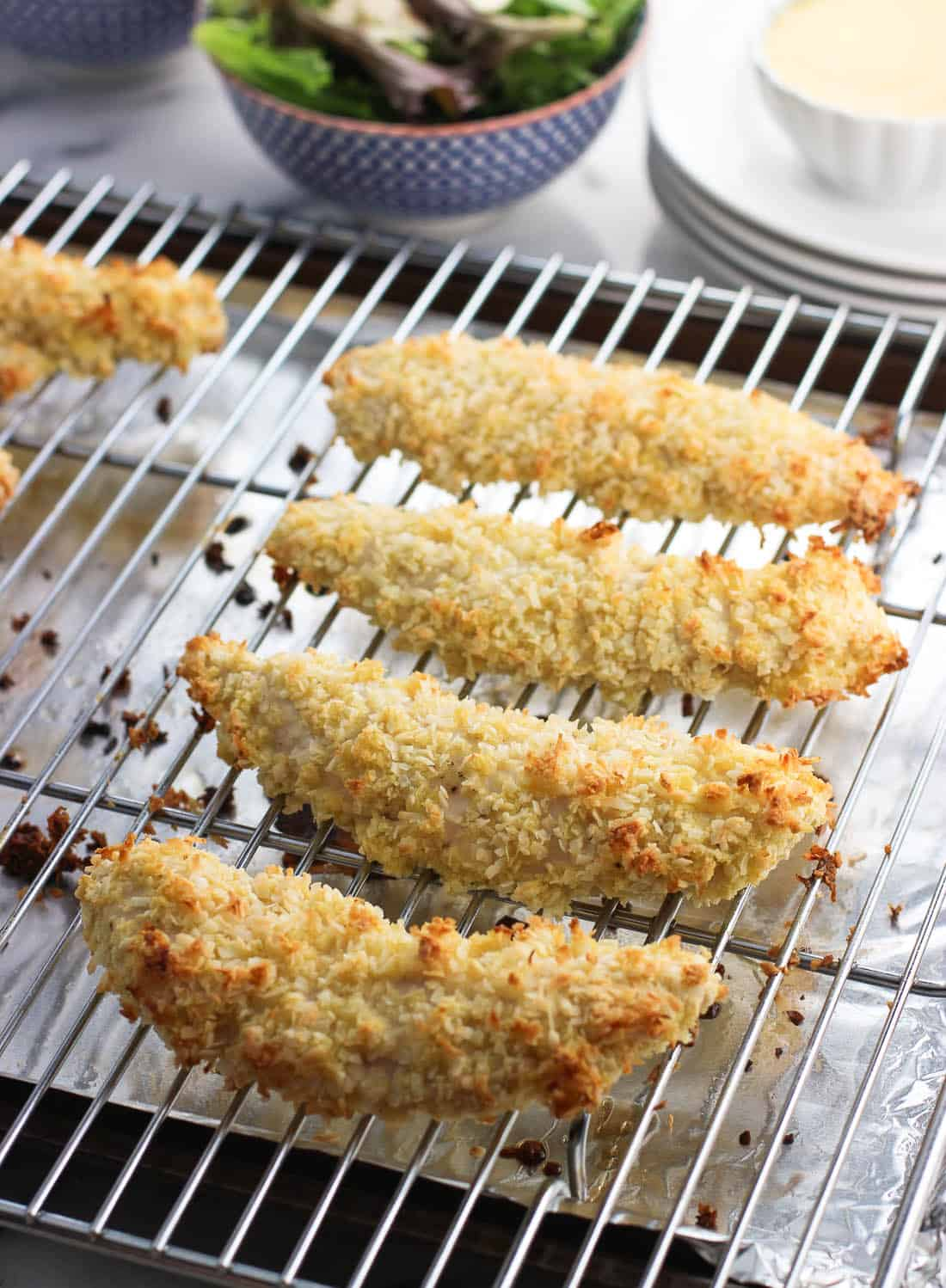 A few steps ensure these easy baked coconut chicken tenders are CRISP for a satisfying, healthier dinner recipe the whole family will love.