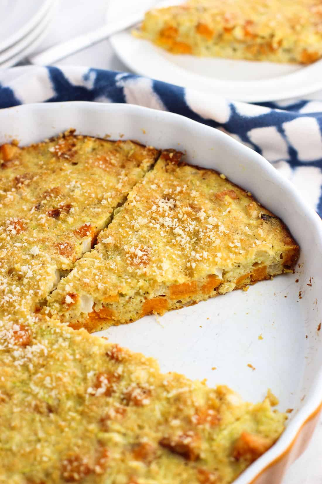 This easy sweet potato zucchini pie features sweet potato chunks, onion, and cheese with a crunchy panko topping. It makes its own crust as it bakes for a simple brunch, lunch, or dinner recipe.