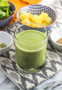 This pineapple matcha vanilla smoothie recipe features baby kale, flaxseed, and Greek yogurt for a healthy and flavorful on-the-go breakfast or anytime pick-me-up.