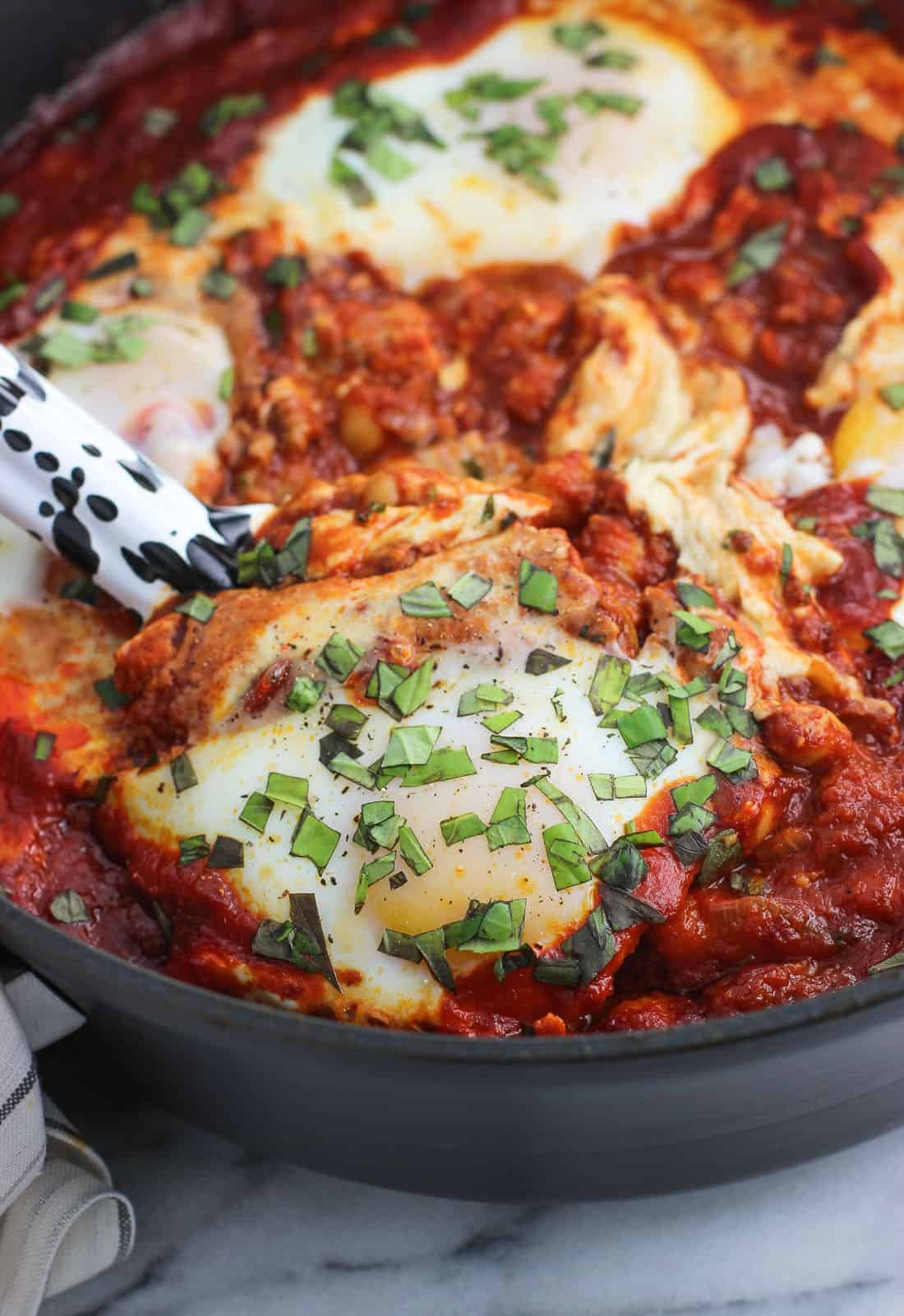 This recipe for shakshuka with chorizo and chickpeas is a quick, one-skillet dinner or anytime meal featuring a smoky spice blend for bold flavor.