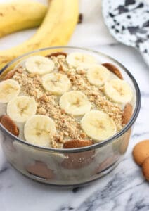 This dairy-free banana pudding features bananas IN the pudding itself for a luscious and boldly-flavored dessert. Layer with wafers and banana slices or enjoy as-is!
