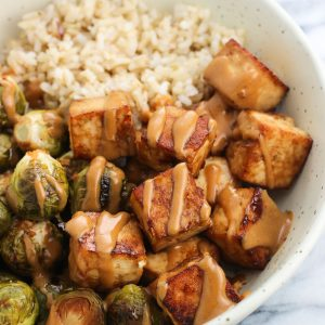 Sheet Pan Tofu with Peanut Sauce and Brussels Sprouts