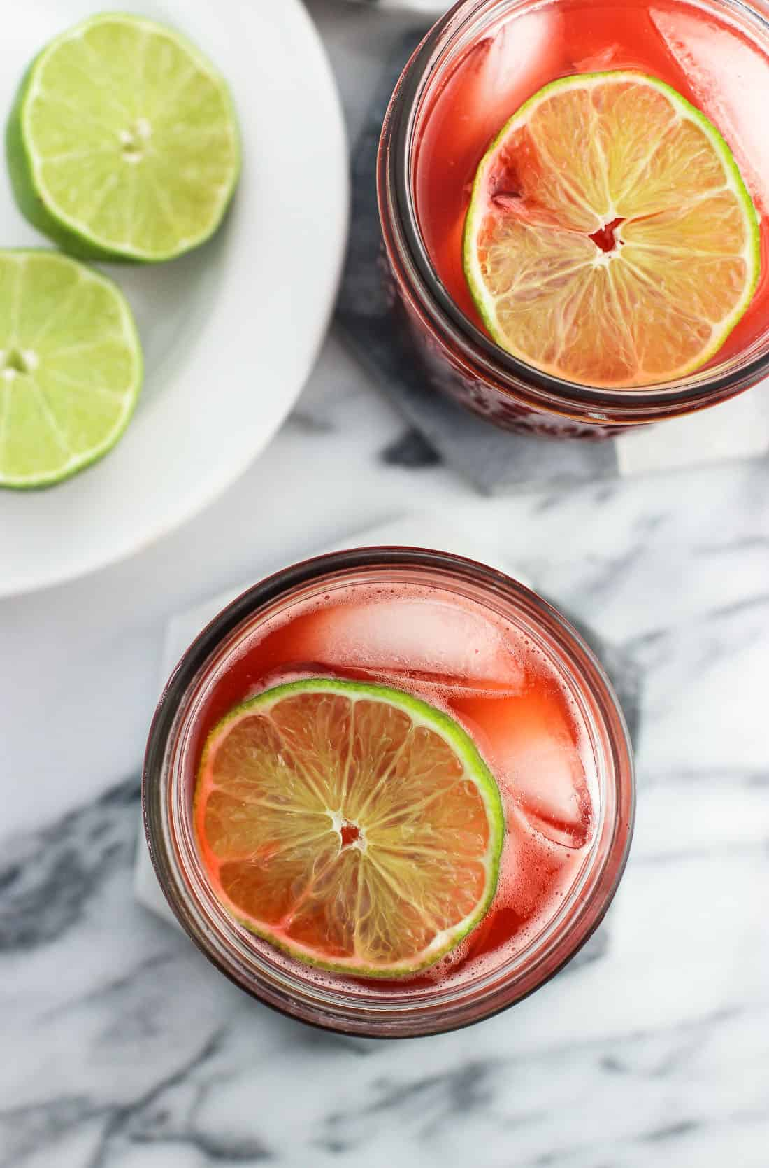 Strawberry drinking vinegar with balsamic is a fruity, refreshing way to drink apple cider vinegar without any 'burn'. Fresh strawberries, lime juice, coconut water, and apple cider and balsamic vinegars make up this naturally-sweetened drink.