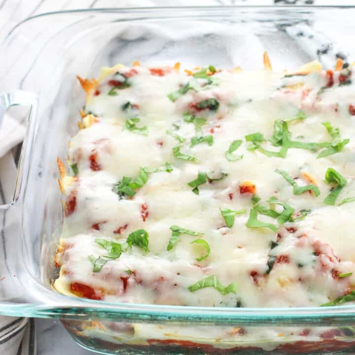Baked ravioli with spinach makes a great weeknight dinner without much effort. Refrigerated ravioli go straight from package to pan along with spinach, mozzarella cheese, and a simple homemade tomato sauce.