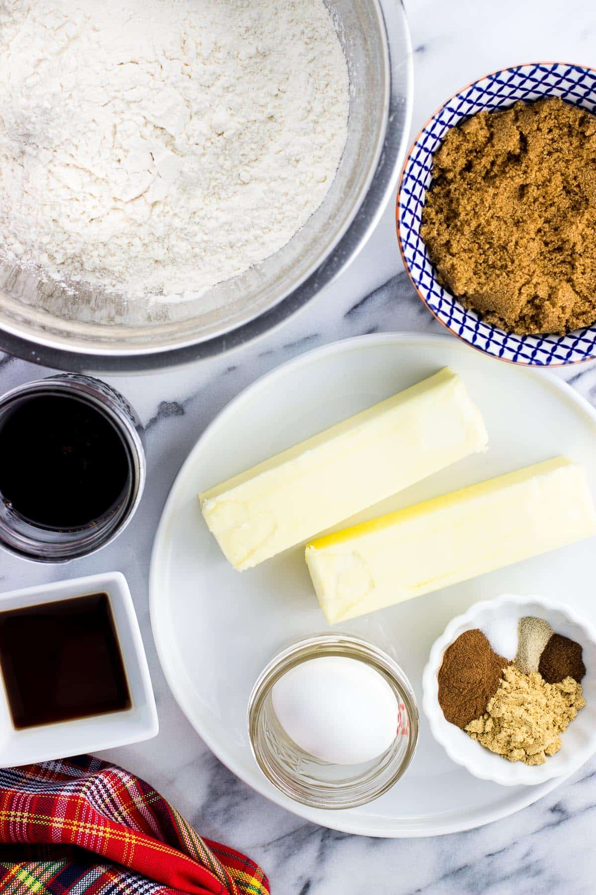 An overhead picture of all of the recipe ingredients in separate containers and bowls on a marble board