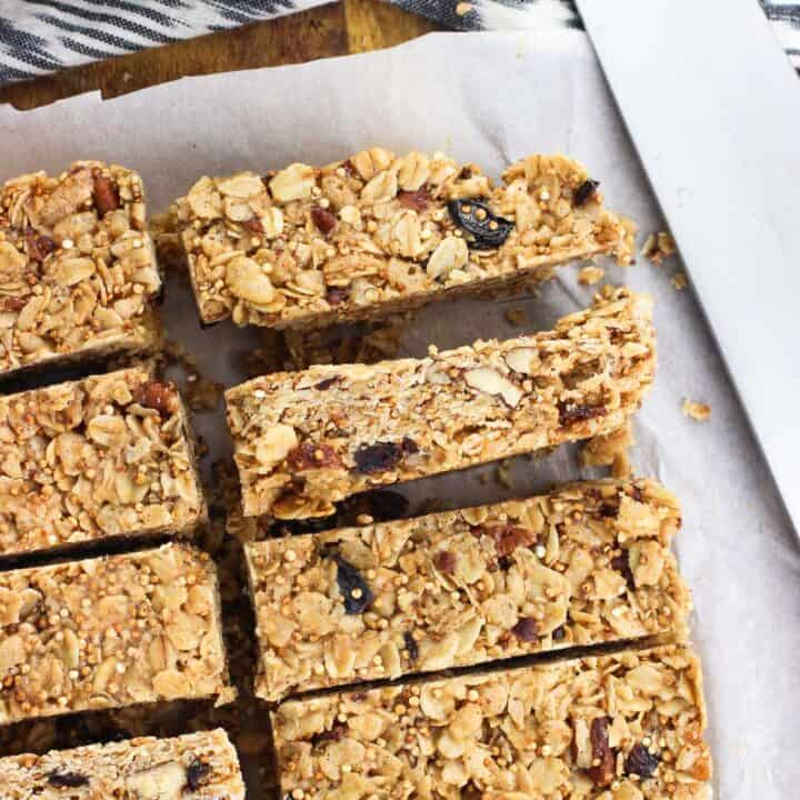 Maple quinoa granola bars are a chewy and satisfying snack bar recipe that features toasted quinoa, pecans, oats, and more. These bars are held together by an almond butter and maple syrup mixture for extra heft and flavor!