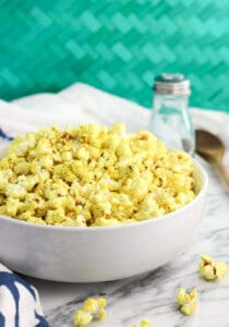Garlic turmeric popcorn with dill takes just minutes to make on the stovetop. Cooking stovetop popcorn with coconut oil yields light and fluffy popcorn that isn't greasy at all. Plus this healthy snack recipe is vegan.