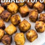 Baked tofu cubes on a plate with recipe name text overlay.