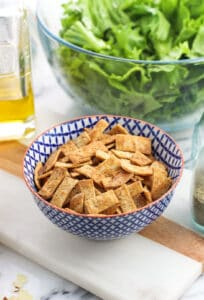 Learn how to make tortilla strips in the oven with this simple method. They crisp up SO well while being oven-baked, and can be seasoned just how you like them. I like to use whole wheat tortillas for a healthier option!