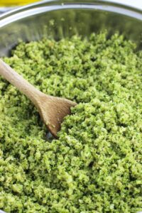 Pesto broccoli rice is a healthy side dish that features the bold flavors of fresh basil, garlic, and Parmesan to make the perfect pairing to chicken, fish, and more. Its light and fluffy texture makes it comparable to traditional rice, but in a lower calorie and low carb version.