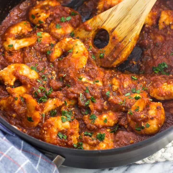 Cooked shrimp in a skillet in spicy tomato sauce