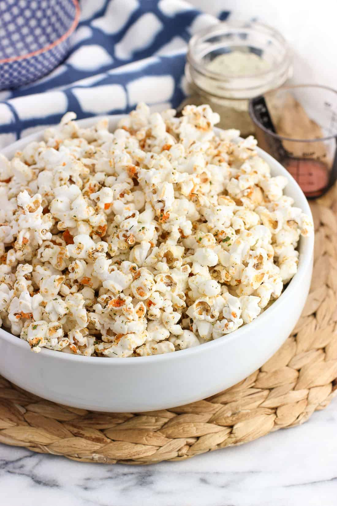 Buffalo ranch popcorn is made right on the stovetop in no time, making this a quick and healthy snack recipe! It's popped in coconut oil and easily flavored with ranch seasoning for zippy flavored popcorn that isn't greasy at all.