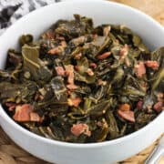 A serving bowl of collard greens.