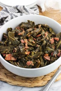 Instant Pot collard greens are a Southern-inspired side dish made much quicker in an electric pressure cooker. These Southern greens have a ton of flavor from bacon and ham, and you'll want to drizzle the cooking liquid on everything!