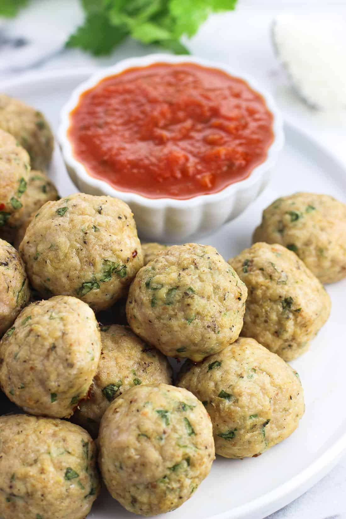 Italian baked turkey meatballs are juicy and healthy, made with lean ground turkey and baked instead of fried. This easy turkey meatball recipe is great on pasta, in meatball subs, and makes a great appetizer when served alongside marinara sauce.