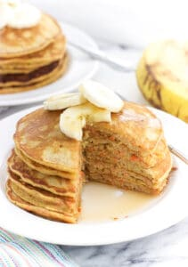 Morning glory blender pancakes are made all in the Braun PureMix Power Blender, cutting down on dishes to wash! These cinnamon spiced pancakes feature an apple, finely grated carrot, and a banana for a satisfying breakfast.