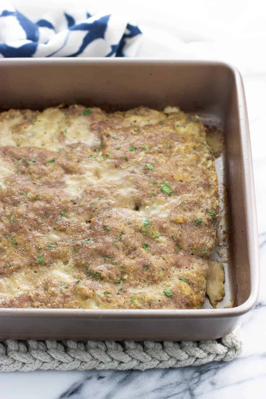 "A slab of turkey meatball mixture baked in an 8"" x 8"" square baking dish"