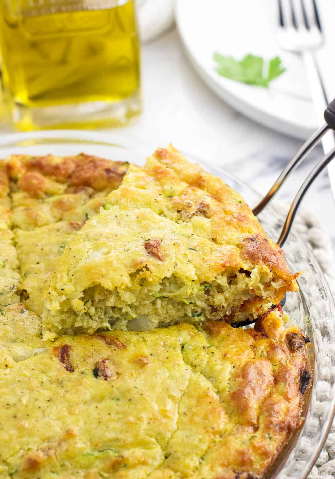 Crustless zucchini quiche is a quicker and easier quiche recipe for a satisfying breakfast or anytime meal. This one-bowl quiche uses Bisquick for structure and features tons of flavor from smoked mozzarella and sun-dried tomatoes.