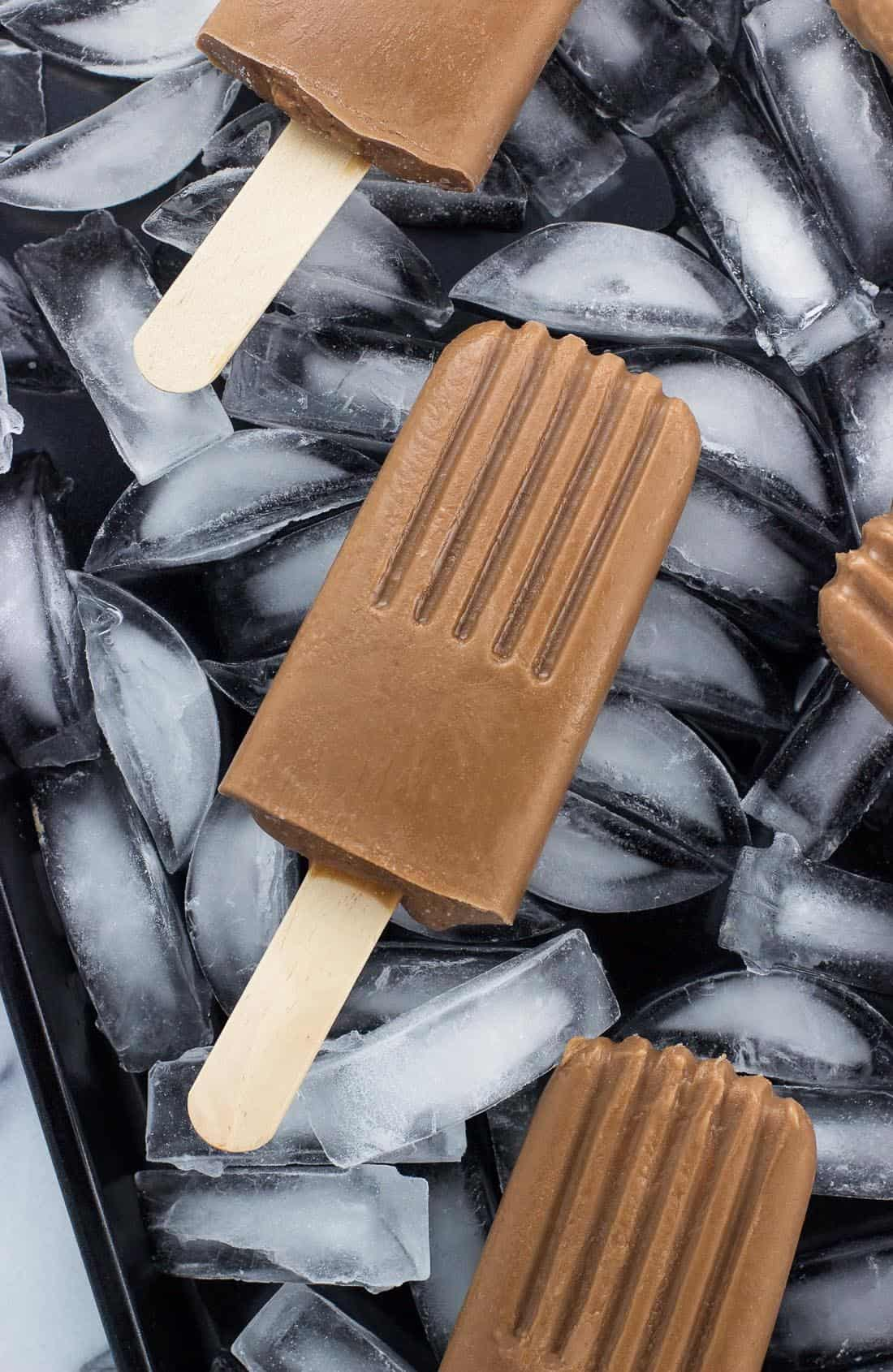 Dairy-free fudgesicles are creamy and so easy to make at home! This chocolate fudge pop recipe is made using a mix of coconut milk and almond milk for a better-for-you dairy-free popsicle treat.