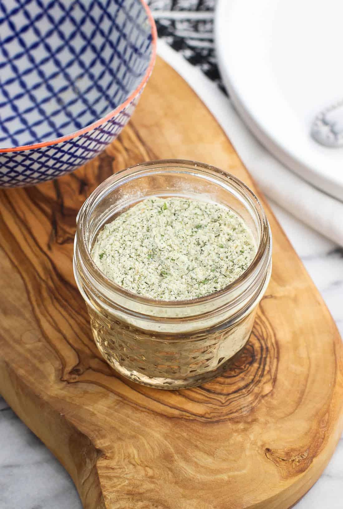 A small glass jar of mixed ranch seasoning.