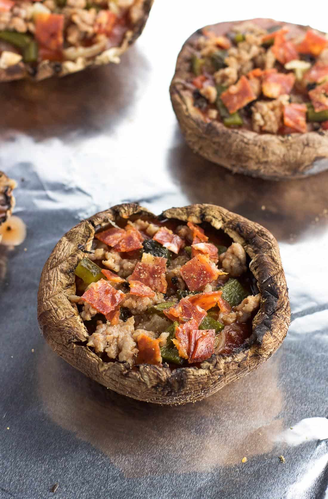 Supreme stuffed portobello mushroom pizzas are a delicious way to enjoy all the flavors of a supreme pizza in a healthier way. A mixture of pizza sauce, Italian sausage, pepperoni, peppers, olives, and more are covered in fresh mozzarella in these easy stuffed portobello mushrooms.