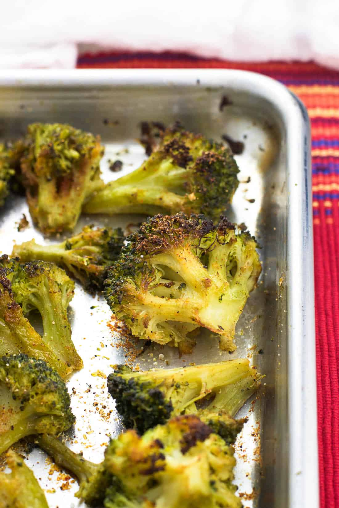 Garlic roasted broccoli with cajun spices is a healthy side dish made even easier by using frozen broccoli. There's no need for thawing in this simple side dish!
