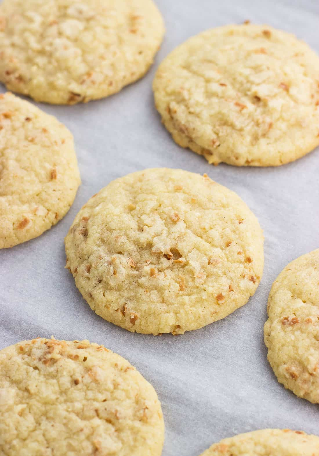 Cookies on a parchment-lined baking sheet.