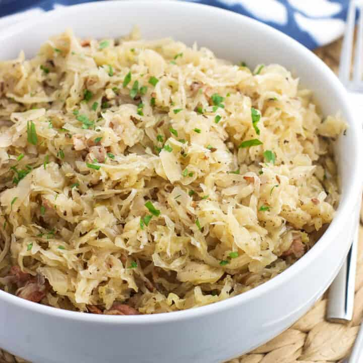 Instant Pot Sauerkraut is SO easy to make in a fraction of the time of traditional from-scratch versions. Just a handful of ingredients and a half hour are all you need to make this hearty side dish recipe.