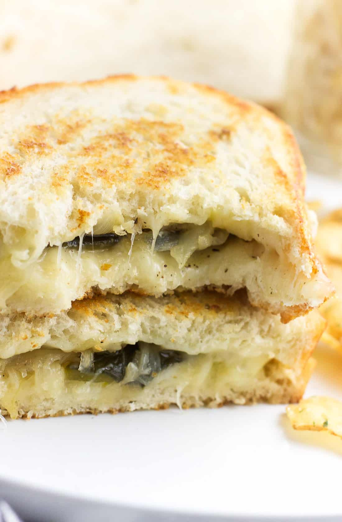 This sourdough havarti grilled cheese is filled with strips of roasted poblano peppers and caramelized onions for an ultra satisfying vegetarian grilled cheese sandwich. Easy comfort food perfect for lunch or dinner!