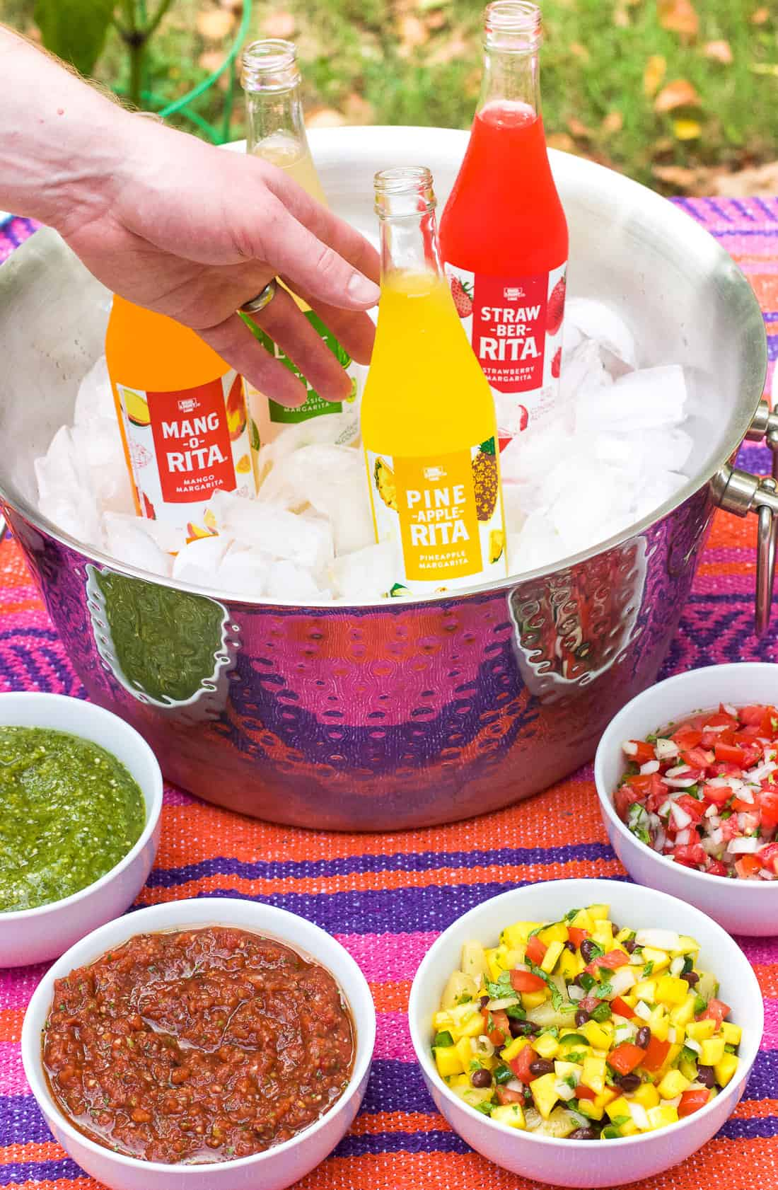 This DIY salsa bar is sure to impress your guests! Featuring four make-ahead homemade salsas, this salsa bar can be customized just to your liking.