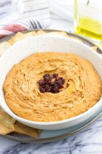 Spicy chipotle hummus is an easy homemade hummus recipe with a powerhouse ingredient: chipotle peppers in adobo. You can adjust the spice level on this healthy dip to right where you want it!