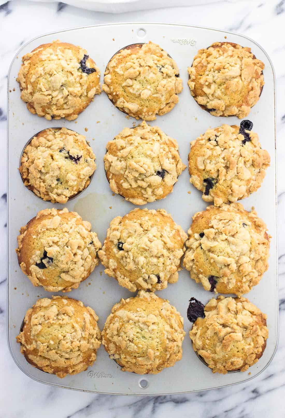 An overhead picture of twelve muffins baked in a muffin tin