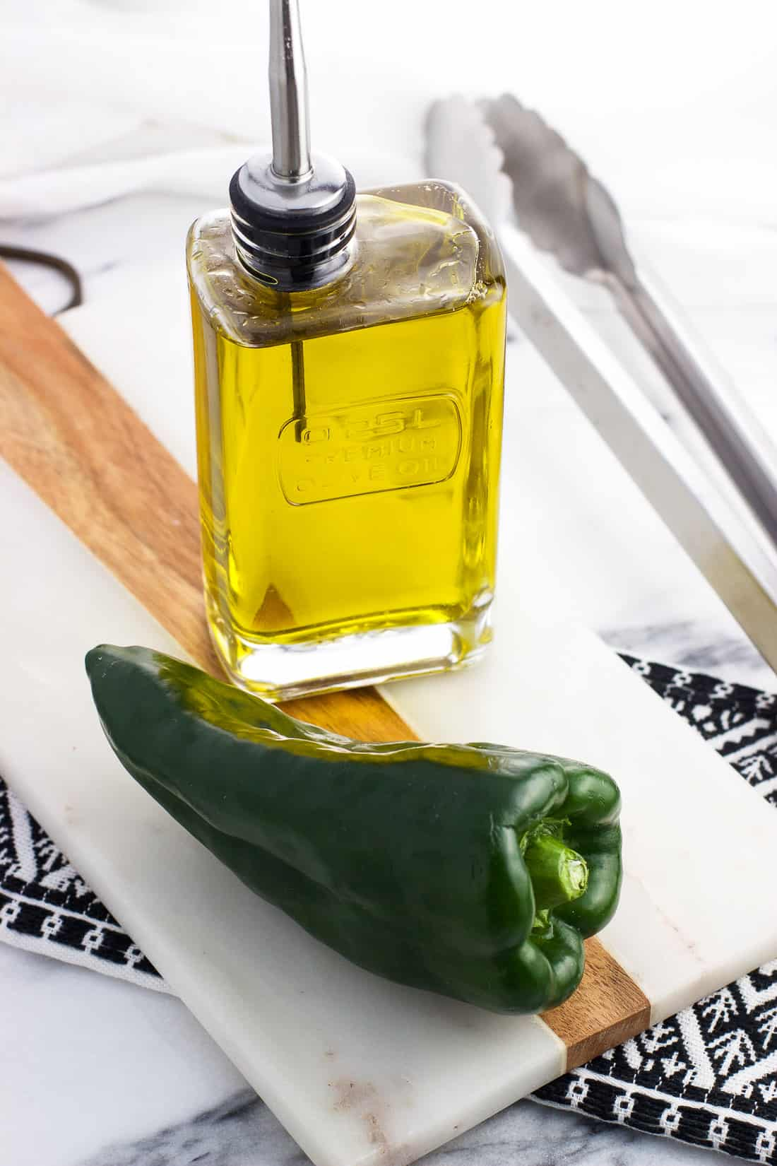 Learn how to roast poblano peppers in the oven (psst -- it's not hard!). Just a little bit of olive oil and a baking sheet are all you need to make roasted peppers year-round and in any kind of stove. These are so great in tacos and on sandwiches!