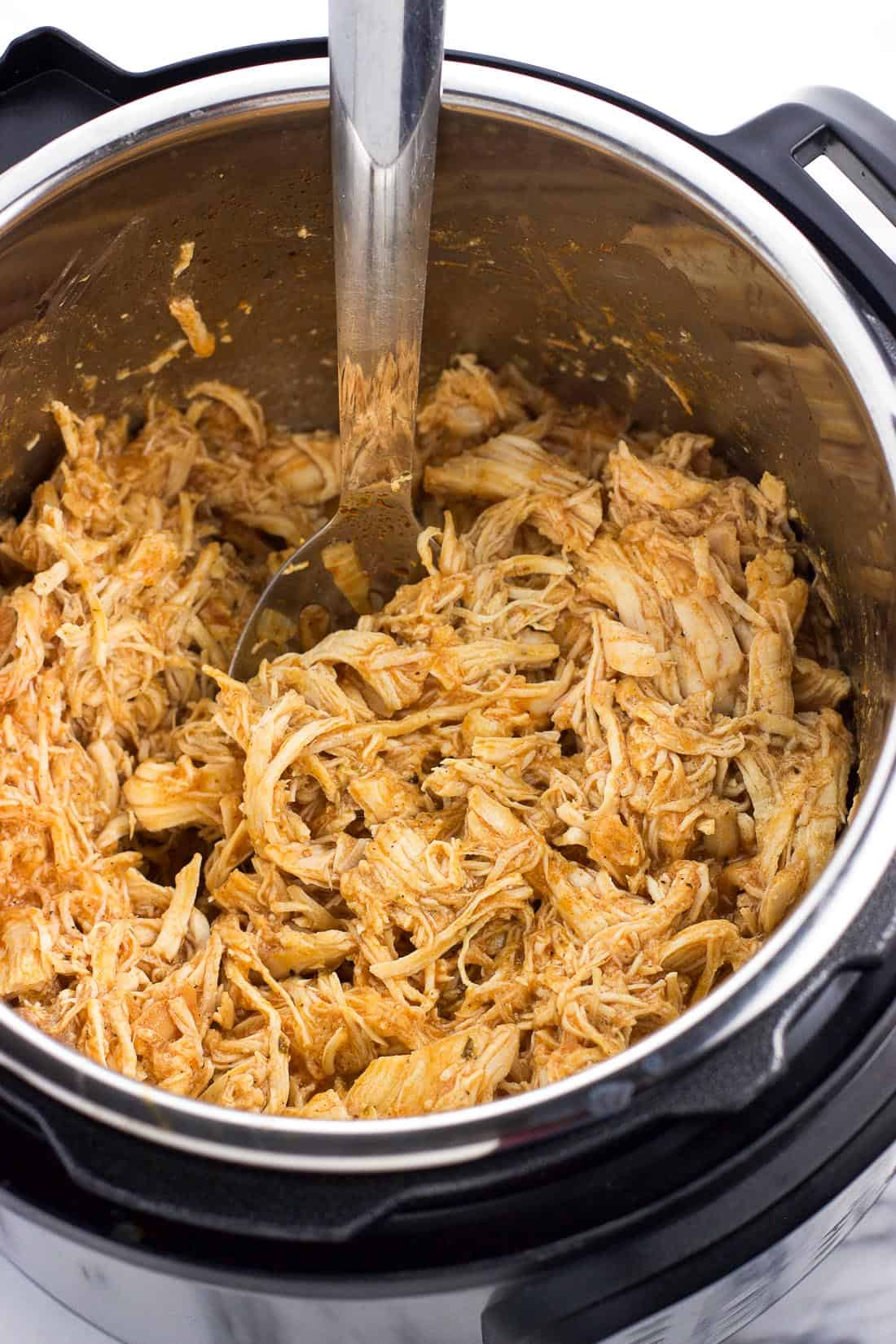 Instant Pot buffalo chicken is an easy and healthy dinner that can be served so many different ways. Just add everything to the Instant Pot and cook! This makes a great meal prep recipe.