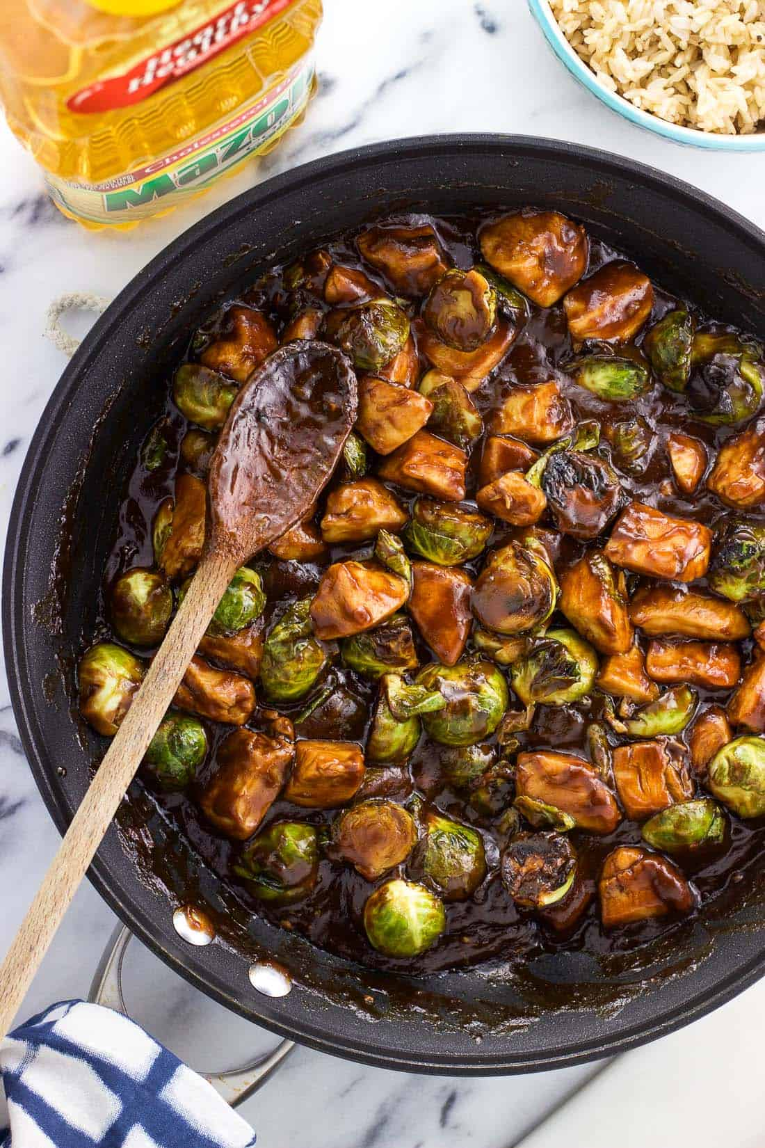 Balsamic peanut chicken stir fry with brussels sprouts makes a delicious one pan dinner! This hearty main dish recipe is done in 30 minutes, making this satisfying meal perfect for busy weeknights.