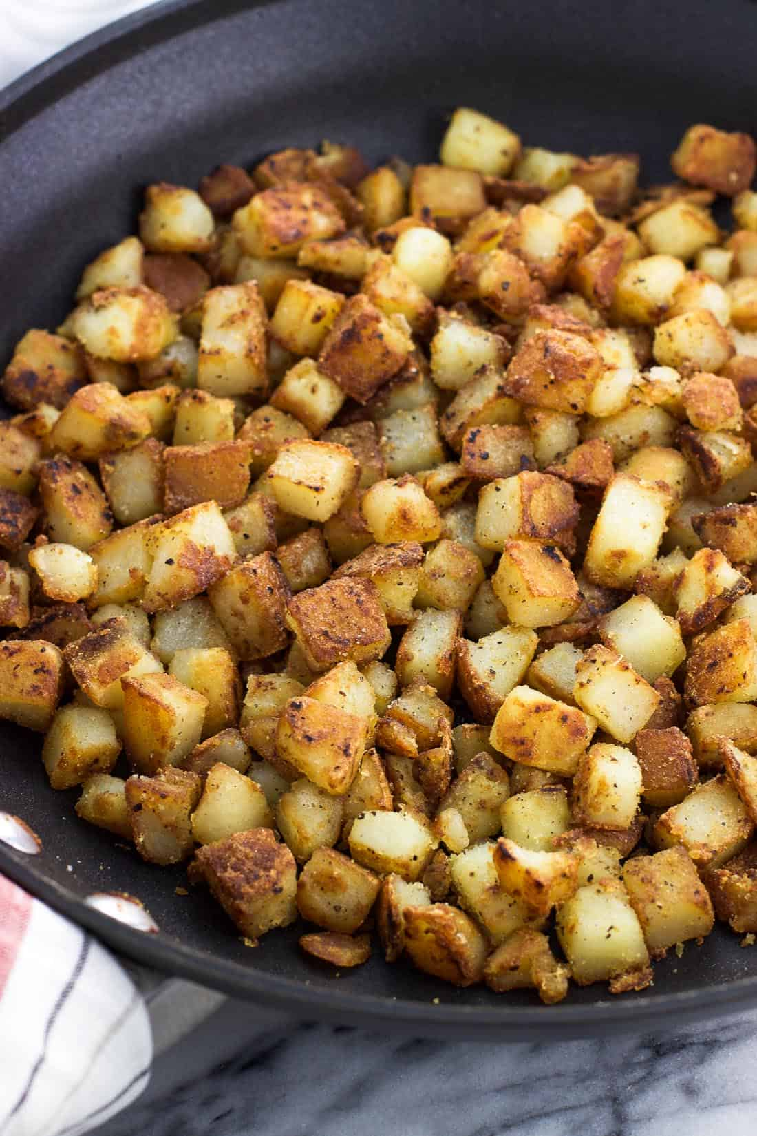 Cubed and sauteed potatoes in a skillet