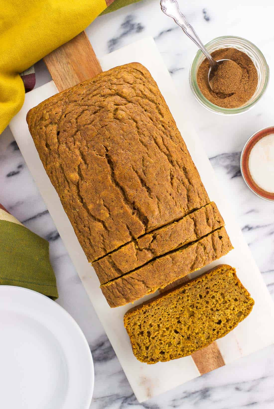 Naturally sweetened pumpkin bread is made with maple syrup for a wonderfully flavored and not-too-sweet quick bread recipe. This moist pumpkin bread is easy to make, flavored with a warm blend of spices, and made without refined sugars.