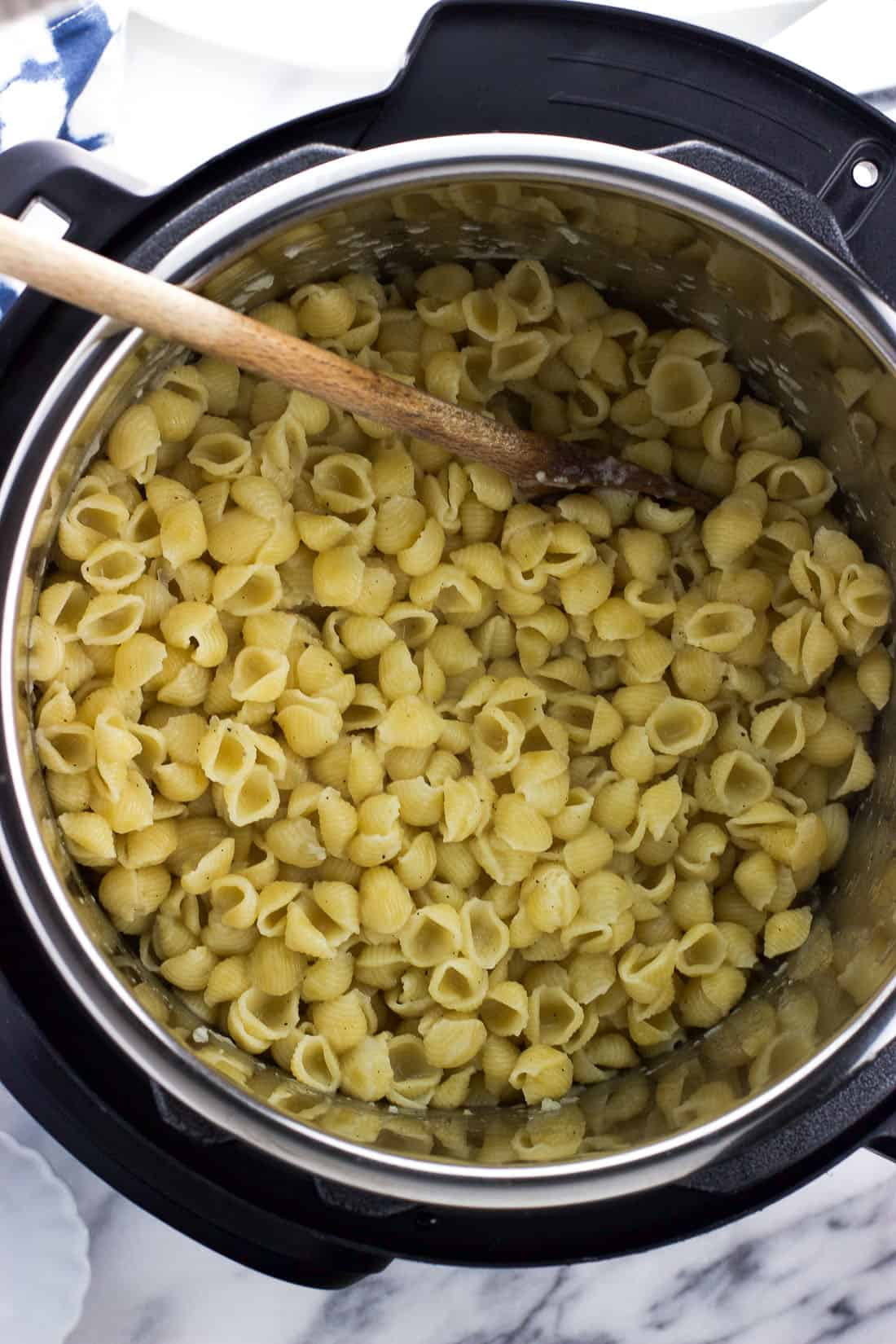 Cooked pasta in the Instant Pot insert after pressure cooking and before stirring in milk and cheese