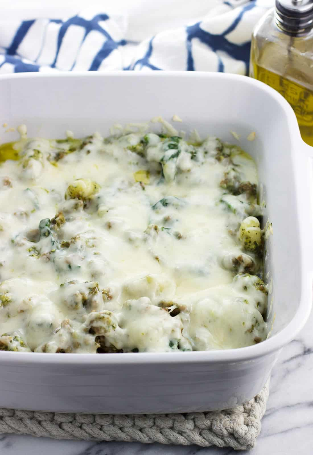 This pesto gnocchi bake features hot sausage and spinach for an easy, weeknight-ready meal. Total comfort food!