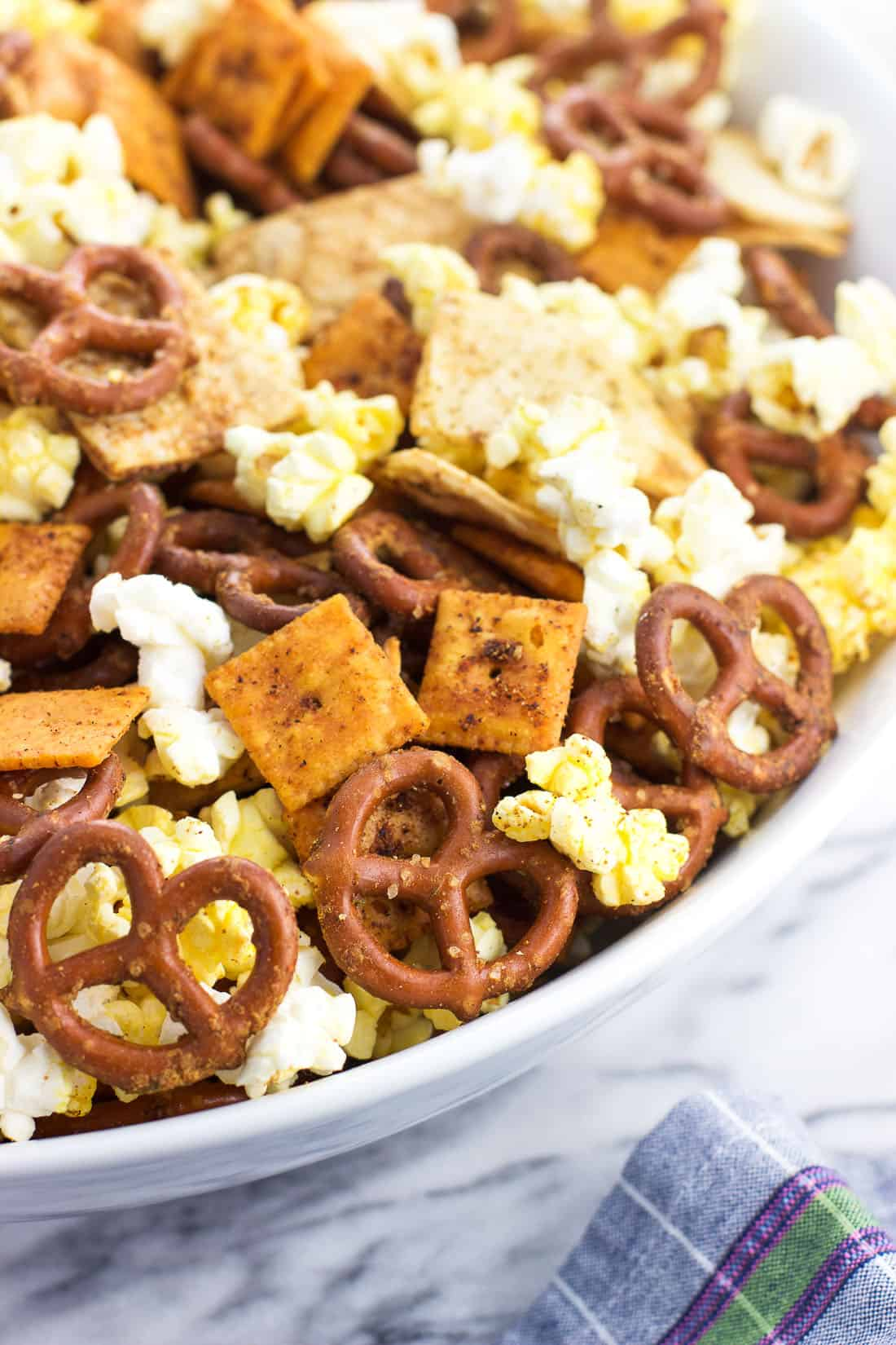 Assembled popcorn snack mix in a large serving bowl
