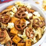 A bowl of popcorn snack mix