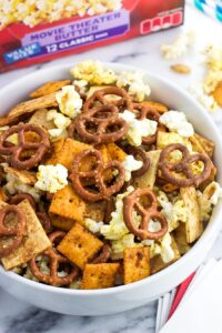 Taco Ranch Popcorn Snack Mix, with cheese crackers, tortilla strips, pumpkin seeds, pretzels, and Orville Redenbacher's popcorn, is an easy-to-make snack mix recipe. Perfect for Game Day!