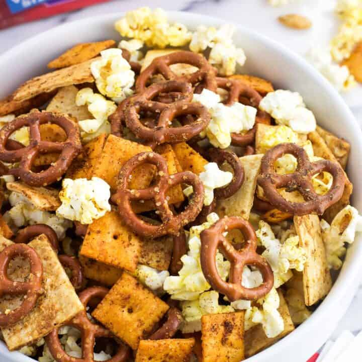A bowl of popcorn snack mix