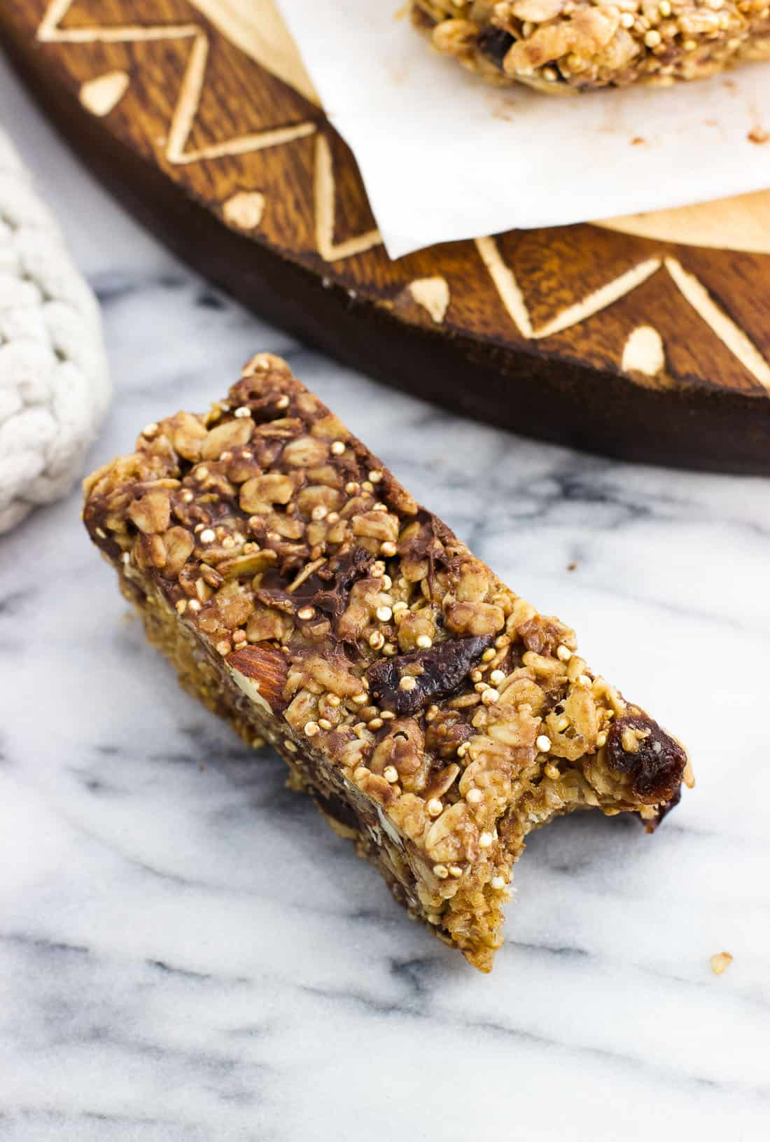 Cherry chocolate chip granola bars are LOADED with nutritious and filling ingredients making them an awesome, healthy snack recipe.  These chewy granola bars feature almond butter, honey, quinoa, dried cherries, oats, and almonds for a deliciously jam-packed snack.
