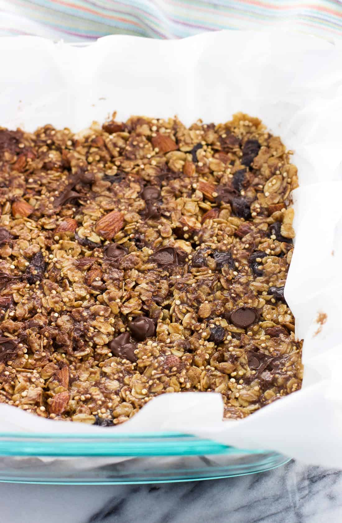The bar mixture pressed into a parchment paper-lined dish