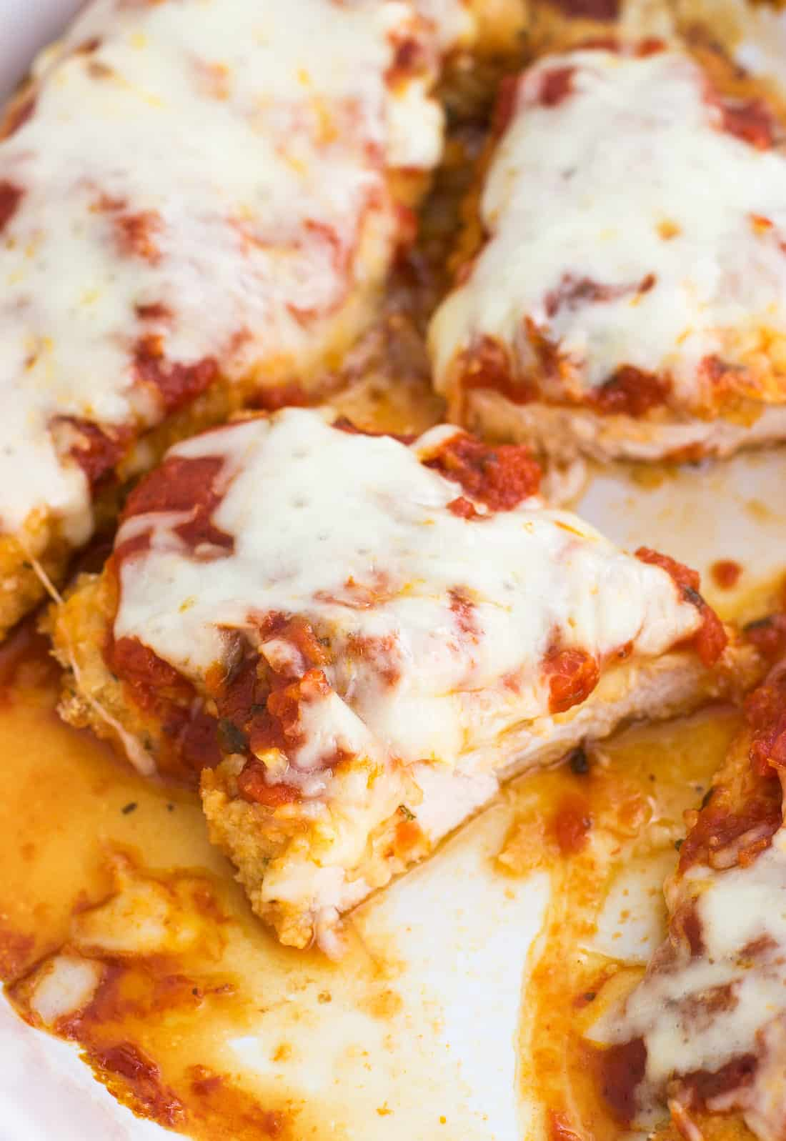 Easy Baked Chicken Parmesan is a quick and satisfying meal made better for you. This healthy chicken parmesan recipe is so simple to put together. It's hard to beat comfort food like this.