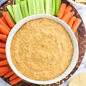 Healthy buffalo chicken dip is a better-for-you version of a party favorite! Creamy and spicy, this easy warm dip features a stealthy secret ingredient that ups the protein and fiber.