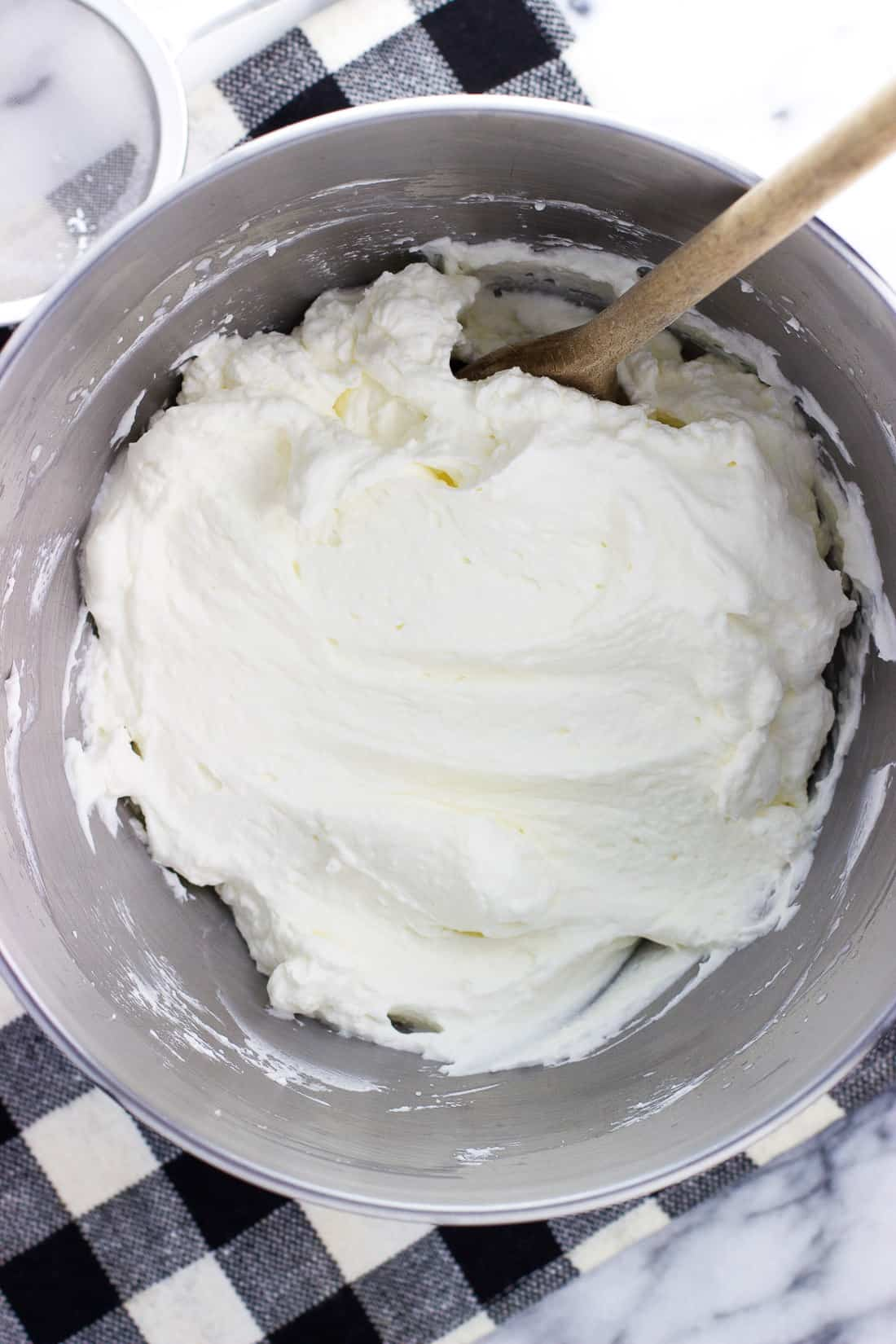 Stabilized whipped cream is so easy to make at home and makes a big difference in pies, trifles, and many more desserts. A quick extra step helps ensure leftover portions of recipes with whipped cream stay fluffy for days.